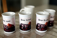 "Coffee mugs given to the brothers by their neighbours. ..The new Munkeby Mariakloster - kloster is Norwegian for monastery . The four founding French monks will establish their discrete presence as a contemplative monastery according to the Rule of Saint Benedict, written in the 6th century. Brother Joel (55) & Cîteaux's Prior, brothers Arnaud (31), Bruno (33) and Cyril (81), have all chosen to be part of the founding community, despite Norway's rude climate and winter darkness at latitude 63º N, not far from the arctic circle.Munkeby, the ""place of the monks"" was the third and northernmost Norwegian monastery established by the Cistercians in the 12th century"