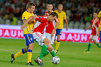 Sweden's Anders Svensson (L) fights for the ball with Hungary's Akos Elek during the UEFA EURO 2012 Group E qualifier Hungary playing against Sweden in Budapest, Hungary on September 02, 2011. ATTILA VOLGYI