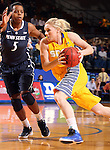 BROOKINGS, SD - DECEMBER 11:  Mariah Clarin #40 from South Dakota State University drives against Talia East #5 from Penn State in the first half of their game Wednesday night at Frost Arena in Brookings. (Photo by Dave Eggen/Inertia)