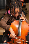 Education elementary public school with music enrichment Kindergarten student playing the cello