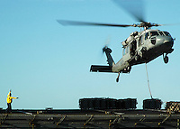 Directing a vertical replenishment at sea alongside USS Abraham Lincoln.