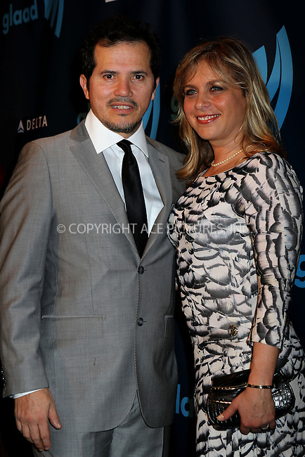 WWW.ACEPIXS.COM....March 16 2013, New York City....Actor John Leguizamo (L) and Justine Maurer arriving at the 24th annual GLAAD Media awards at The New York Marriott Marquis on March 16, 2013 in New York City.....By Line: Nancy Rivera/ACE Pictures......ACE Pictures, Inc...tel: 646 769 0430..Email: info@acepixs.com..www.acepixs.com