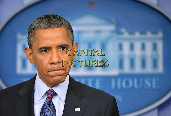 United States President Barack Obama holds a press conference in the Brady Press Briefing Room at the White House in Washington, DC, US..8th June 2012.half length blue tie black suit mouth looks worried upset.CAP/ADM/CNP/KD.©Kevin Dietsch/CNP/AdMedia/Capital Pictures.