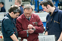 Discussing how to read a Vernier scale on a height gauge.  Apprentice engineering students at Kingston College..
