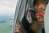 Pará State, Brazil. Cacique Kryt Kayapo in a small aircraft.