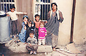 Iran 1991 .In Kani Dinar, left, Saadia, wife of Mahmoud Sangawy, with her children and  her sister-in-law, after the uprising in Kurdistan of Iraq  .Iran 1991  .A Kani Dinar, a gauche, Saadia, femme de Mahmoud Sangawy avec les enfants et sa belle-soeur, apres le soulevement au Kurdistan irakien