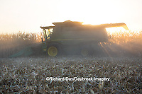 63801-06804 John Deere combine harvesting corn at sunset, Marion Co., IL