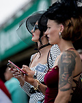 June 8, 2019 : A women is dressed up on Belmont Stakes Festival Saturday at Belmont Park in Elmont, New York. Scott Serio/Eclipse Sportswire/CSM