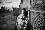 BROOKLYN -- FEBRUARY 08, 2009: Rapper Brooklyn Chase, 24, poses with a friend outside of the abandoned buildings of Prospect Plaza, a housing project complex in Brownsville where his father lived before he died in 1990, on February 08, 2009 in Brooklyn. On a Sunday evening on August 27, 1995 a roller skating 4 year-old Shamone Johnson was caught in the middle of a gun battle in the lobby of 1750 Prospect Place and shot to death while visiting her grandmother. (PHOTOGRAPH BY MICHAEL NAGLE).
