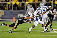 11 October 2008:  FIU linebacker Tyler Clawson (49) attempts to tackle Middle Tennessee State running back Phillip Tanner (21) in the FIU 31-21 victory over Middle Tennessee at FIU Stadium in Miami, Florida.