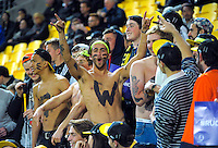 Fans in the grandstand during the Super Rugby match between the Hurricanes and Reds at Westpac Stadium, Wellington, New Zealand on Saturday, 14 May 2016. Photo: Dave Lintott / lintottphoto.co.nz