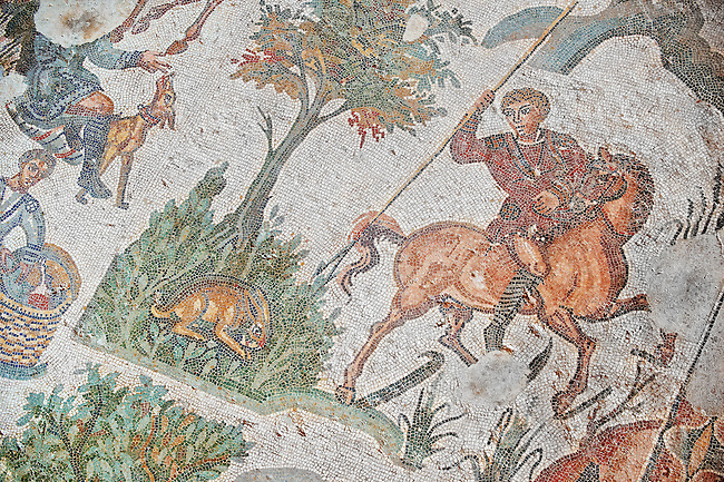 Hunter on horseback  about to spear a crouching hare From the Room of The Small Hunt, no 25 - Roman mosaics at the Villa Romana del Casale which containis the richest, largest and most complex collection of Roman mosaics in the world, circa the first quarter of the 4th century AD. Sicily, Italy. A UNESCO World Heritage Site.