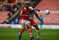 Blackpool's Armand Gnanduillet vies for possession with Barnsley's Ethan Pinnock<br /> <br /> Photographer Alex Dodd/CameraSport<br /> <br /> The EFL Sky Bet League One - Barnsley v Blackpool - Saturday 27th April 2019 - Oakwell - Barnsley<br /> <br /> World Copyright © 2019 CameraSport. All rights reserved. 43 Linden Ave. Countesthorpe. Leicester. England. LE8 5PG - Tel: +44 (0) 116 277 4147 - admin@camerasport.com - www.camerasport.com