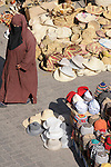 A woman walks through the market in Marrakesh, Morocco.