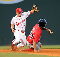 July 29, 2009: Greenville Drive second baseman Zach Gentile (7) applies the tag too late as Anthony Gose (24) of the Lakewood BlueClaws steals his Minor League-leading 57th base in the fifth inning of a game at Fluor Field at the West End in Greenville, S.C. Photo by: Tom Priddy/Four Seam Images