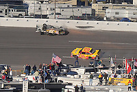 Nov. 1, 2009; Talladega, AL, USA; NASCAR Sprint Cup Series driver Ryan Newman (39) slides on his roof after crashing during the Amp Energy 500 at the Talladega Superspeedway. Mandatory Credit: Mark J. Rebilas-