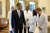 Washington, DC - October 5, 2009 -- United States President Barack Obama laughs with doctors from around the country in the Oval Office, Monday, October 5, 2009, prior to a health insurance reform event at the White House in Washington, D.C.  .Mandatory Credit: Pete Souza - White House via CNP