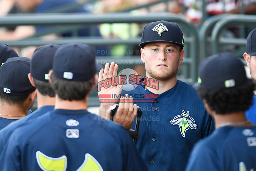 Starting pitcher Chase Ingram (18) of the Columbia Fireflies is greeted after coming out of a game against the Augusta GreenJackets on Sunday, July 30, 2017, at Spirit Communications Park in Columbia, South Carolina. Augusta won, 6-0. (Tom Priddy/Four Seam Images)