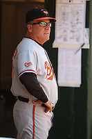 OAKLAND, CA - APRIL 18:  Manager Dave Trembley #47 of the Baltimore Orioles watches from the dugout during the game against the Oakland Athletics at the Oakland-Alameda County Coliseum on April 18, 2010 in Oakland, California. The Orioles beat the A's 8-3. Photo by Brad Mangin