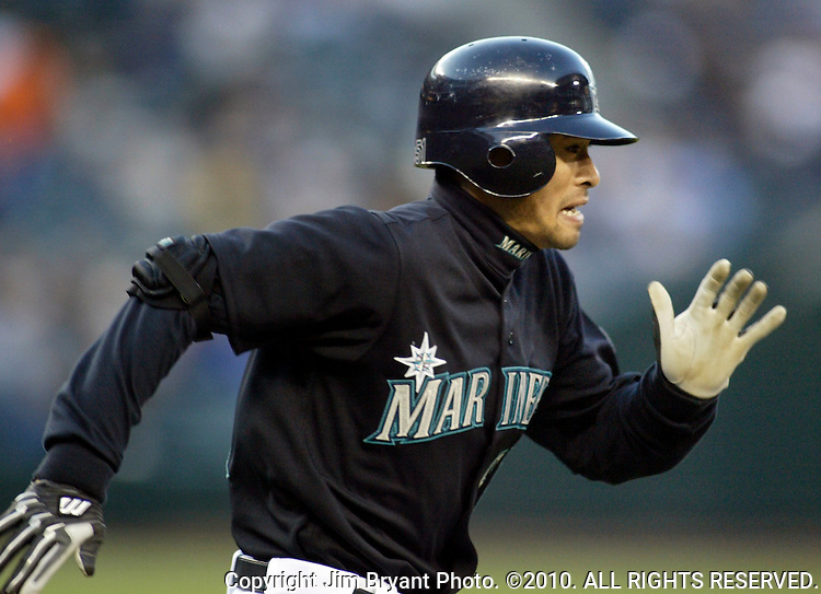 Seattle Mariners' Ichiro Suzuki tries to beat the throw to first bast in the fourth inning of their American League game against the Los Angeles Angels at Safeco Field in Seattle, Washington on Monday, 2 May 2005. Jim Bryant Photo. ©2010. ALL RIGHTS RESERVED.