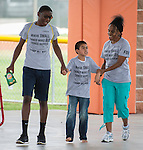 Home Run Hitters International staff, and volunteers work with students during Camp Mi Way at T.H. Rogers June 25, 2014.