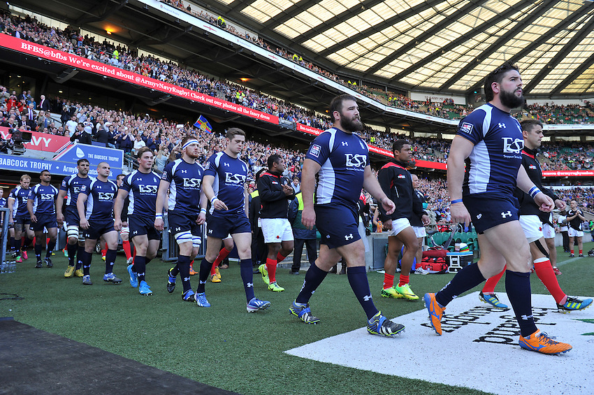 The Army and Navy players walk out onto the pitch<br /> <br /> Photographer Ashley Western/CameraSport<br /> <br /> Rugby Union - Babcock Trophy - Army v Navy - Saturday 3rd May 2014 - Twickenham - London<br /> <br /> &copy; CameraSport - 43 Linden Ave. Countesthorpe. Leicester. England. LE8 5PG - Tel: +44 (0) 116 277 4147 - admin@camerasport.com - www.camerasport.com