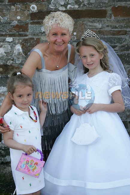 Cathy Mulready, who made her First Communion on Saturday at Clogherhead church, pictured with Phil and Sophie Keogh.