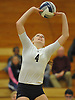 Jamie Smith #4 of Massapequa, right, makes a set as Margaret O'Malley-Rebovich #20 of Long Beach defends at the net during the Nassau County varsity girls volleyball Class AA championship at SUNY Old Westbury on Tuesday, Nov. 8, 2016. Massapequa won 3-0.