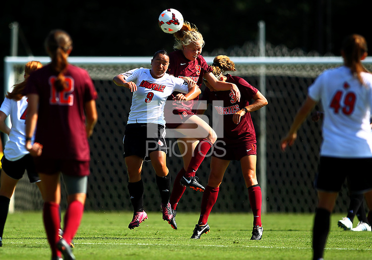 WINSTON-SALEM, NORTH CAROLINA - August 30, 2013:<br />  Charlyn Corral (9) of Louisville University goes up for a header against Kelsey Loupee (9) of Virginia Tech during a match at the Wake Forest Invitational tournament at Wake Forest University on August 30. The game ended in a 1-1 tie.