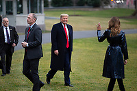 United States President Donald J. Trump walks toward Marine One on the South Lawn of the White House in Washington D.C., U.S. as he and First lady Melania Trump depart to attend the College Football Playoff National Championship in New Orleans, Louisiana on Monday, January 13, 2020.  The Senate is set to begin his impeachment trial later this week, after Speaker of the United States House of Representatives Nancy Pelosi (Democrat of California) faced increased pressure to send over the two articles of impeachment. <br /> CAP/MPI/RS<br /> ©RS/MPI/Capital Pictures