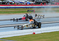 May 15, 2011; Commerce, GA, USA: NHRA top fuel dragster driver Tony Schumacher (near) races Ike Maier during the Southern Nationals at Atlanta Dragway. Mandatory Credit: Mark J. Rebilas-