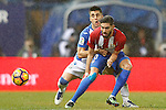 Atletico de Madrid's Yannick Ferreira Carrasco (r) and CD Leganes' Unai Bustinza during La Liga match. February 4,2016. (ALTERPHOTOS/Acero)