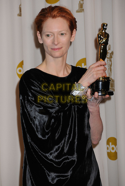 TILDA SWINTON.The 80th Annual Academy Awards Press Room held at the Kodak Theatre, Hollywood, California, USA..February 24th, 2008.oscars half length black dress diamond bracelet award trophy winner .CAP/ADM/BP.©Byron Purvis/AdMedia/Capital Pictures.