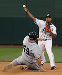 Reno Aces second baseman Abraham Nunez turns a double play in the top of the fourth inning as Tacoma's Brad Nelson slides into second base.  Tom Smedes photo.