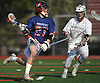 Aidan Mulholland #27 of Manhasset, left, circles around the net during the 133rd Woodstick Classic against host Garden City High School on Saturday, April 28, 2018. He assisted on the game-winning goal midway through the fourth quarter in Manhasset's 7-4 victory.