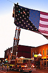 A fire truck ladder squad provdes a lift in hanging the flag before the Quad Cities Marathon 2009<br />