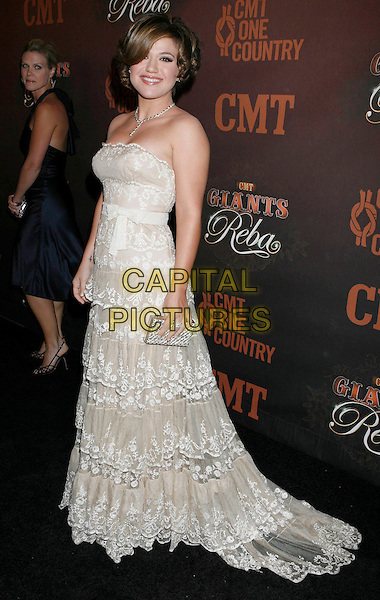 "KELLY CLARKSON.Arrivals at ""CMT Giants"" Honoring Reba McEntire held at the Kodak Theatre, Hollywood, LA, California, USA,.26 October 2006..full length white lace ruffle layered dress strapless.Ref: ADM/RE.www.capitalpictures.com.sales@capitalpictures.com.©Russ Elliot/AdMedia/Capital Pictures."