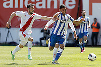 Rayo Vallecano's Javi Fuego (l) and Real Sociedad's Carlos Vela during La Liga match.April 14,2013. (ALTERPHOTOS/Acero)