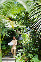 A member of staff walks down one of the many secluded paths in the grounds of the Maia Luxury Resort & Spa