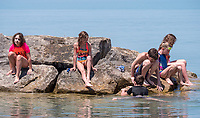 One of the perks of home schooling is a  water trip to the beach, while everyone else is in school. The Brights Grove beach was an attraction for this group of six students and there moms relaxing under beach umbrella's. Taking part in the water study are; Quinn Munroe, 11, Avery Munroe, 11, Laura Silk, 10, Julia Silk, 9, Hudson Silk and Nik Botma, all of the Camlachie and Forest area.