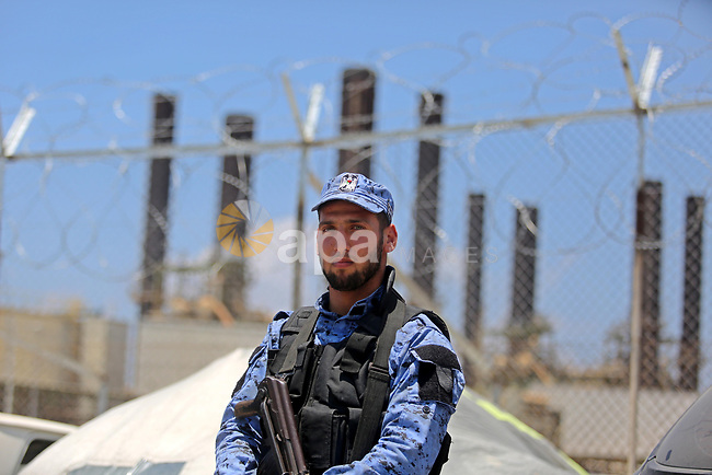 A member of Palestinian security forces stands guard as Egyptian trucks carrying fuel arrive to Gaza's power plant in Nusseirat, in the central Gaza Strip after entering the southern Gaza Strip from Egypt through the Rafah border crossing on June 21, 2017. Egypt began to deliver a million litres of fuel to Gaza, a Palestinian official said, in an attempt to ease the Palestinian enclave's desperate electricity crisis. The fuel, trucked in through the Rafah border between Egypt and Gaza, will be routed to the territory's only power station -- closed since April due to fuel shortages. Photo by Ashraf Amra