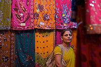 Women buying sari Varanasi Ganges India