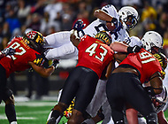 College Park, MD - NOV 25, 2017: Penn State Nittany Lions running back Saquon Barkley (26) dives over the top of the pile for a Penn State touchdown during game between Maryland and Penn State at Capital One Field at Maryland Stadium in College Park, MD. (Photo by Phil Peters/Media Images International)