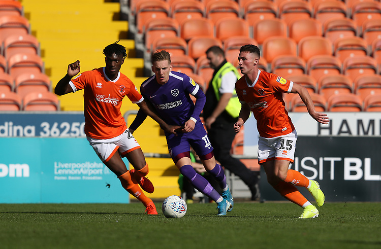 Blackpool's Jordan Thompson watched by Portsmouth's Ronan Curtis<br /> <br /> Photographer Stephen White/CameraSport<br /> <br /> The EFL Sky Bet League One - Blackpool v Portsmouth - Saturday 31st August 2019 - Bloomfield Road - Blackpool<br /> <br /> World Copyright © 2019 CameraSport. All rights reserved. 43 Linden Ave. Countesthorpe. Leicester. England. LE8 5PG - Tel: +44 (0) 116 277 4147 - admin@camerasport.com - www.camerasport.com
