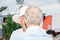 Democratic presidential candidate Tom Steyer speaks with farmers, including Kyle Gilchrist (cowboy hat) of Douds, Iowa, at the Iowa State Fair in Des, Moines, Iowa, on Sun., Aug. 11, 2019. Gilchrist was concerned about what an increasing minimum wage means for paying his farm workers.