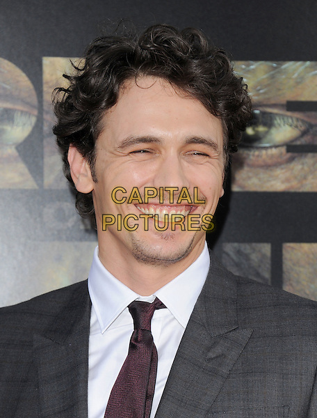 "James Franco.""Rise of the Planet of the Apes"" Los Angeles Premiere held at Grauman's Chinese Theatre, Hollywood, California, USA..July 28th, 2011.headshot portrait white grey gray stubble facial hair smiling      .CAP/RKE/DVS.©DVS/RockinExposures/Capital Pictures."