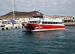 Tourist ferry boat Biosfera Express leaving the harbour Caleta de Sebo, La Isla Graciosa, Lanzarote, Canary Islands, Spain