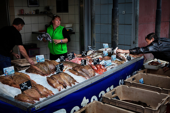 One of the number of fish stalls that run alongside the quay in the port of Boulogne-sur-Mer, France. <br />