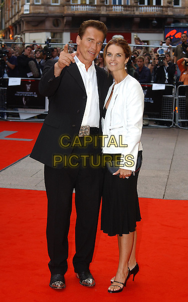 """ARNOLD SCHWARZENEGGER.& MARIA SHRIVER.""""Terminator 3"""" film premiere.Odeon, Leicester Square.sales@capitalpictures.com.www.capitalpictures.com.©Capital Pictures.full length, full-length, steel cap cowboy boots, pointing, arnie"""