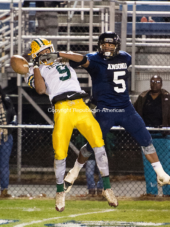 ANSONIA, CT - 7 December 2015-120715EC03-- Ansonia's Tyler Bailey is unable to receive a pass Monday night next to Trinity Catholic's Izaiah Sanders. Erin Covey Republican-American.